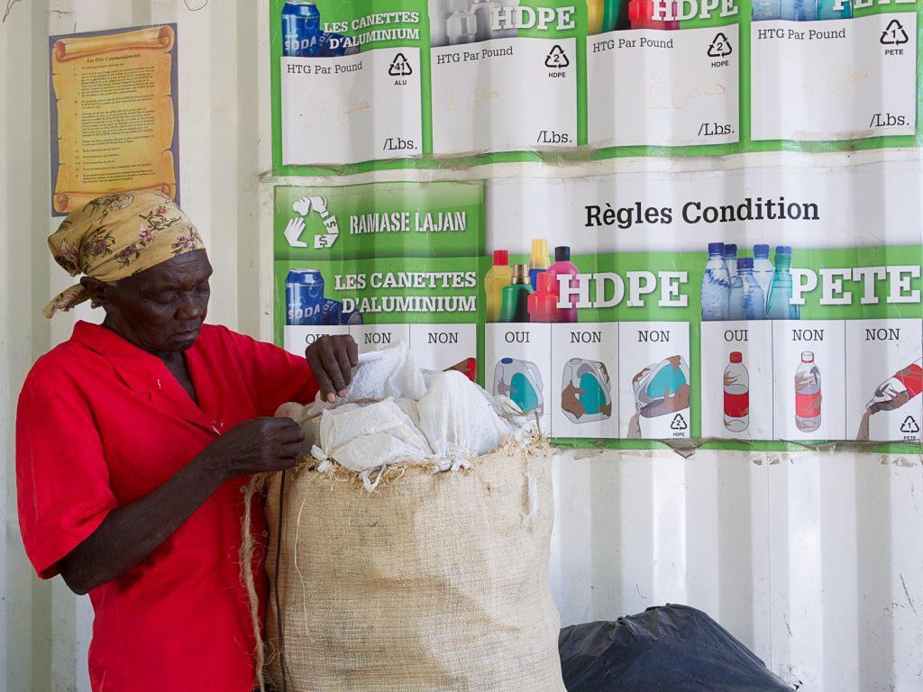 Woman sorts plastics for recycling