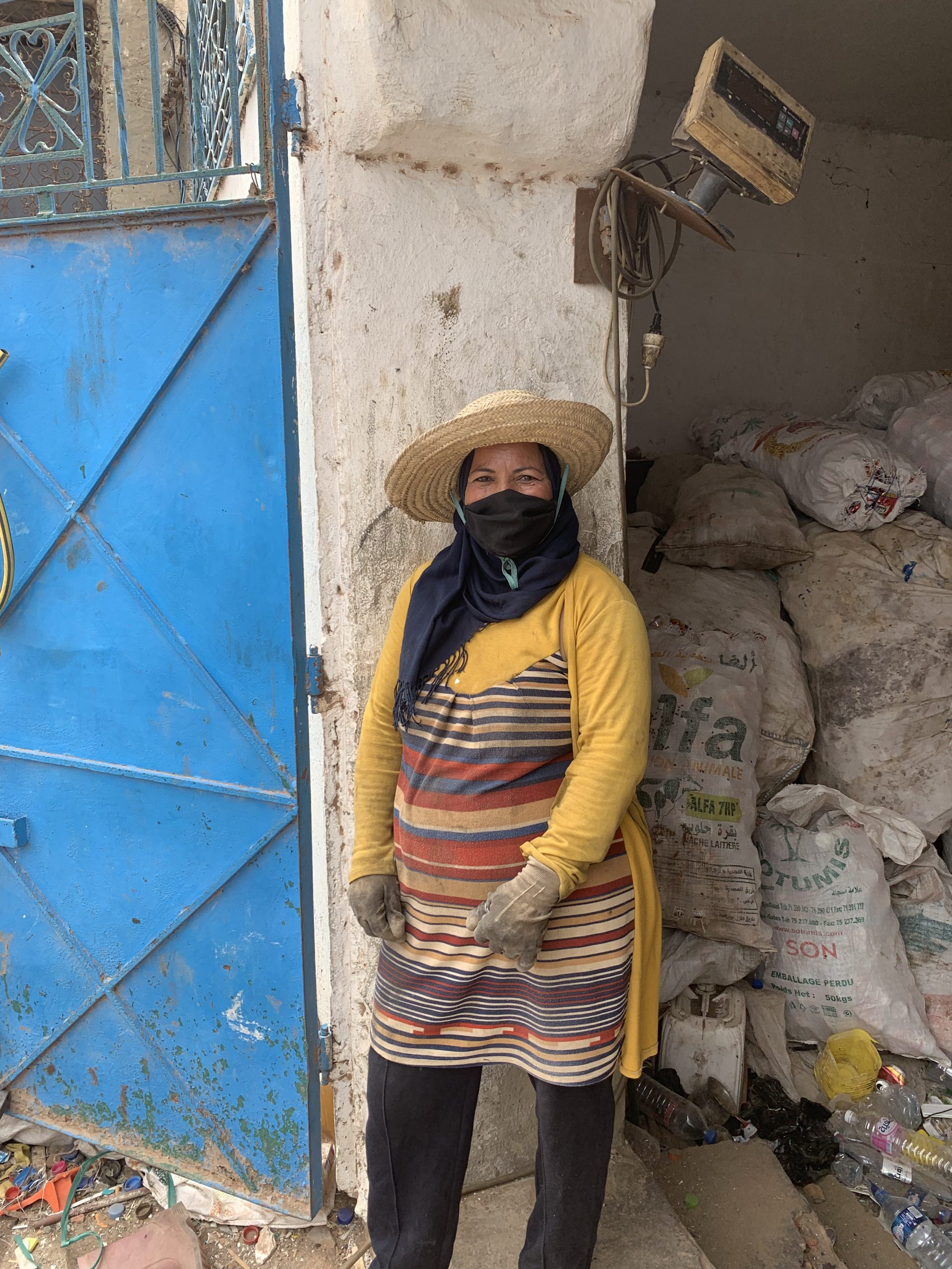 Jemmal, Tunisia: lady stands outside a collection point