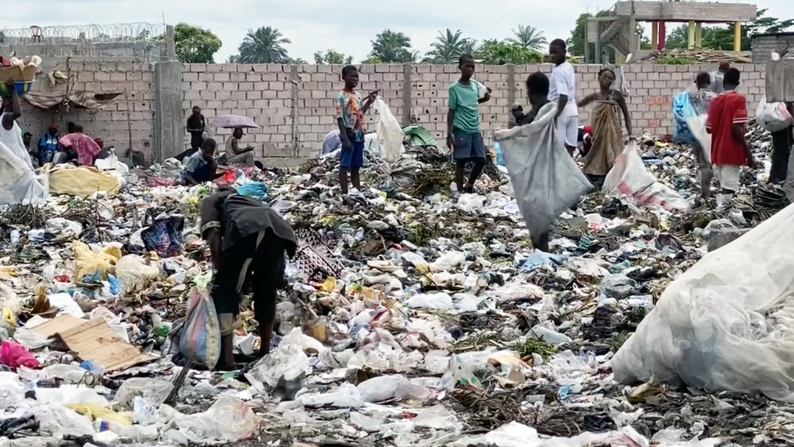 Children in DRC picking through trash at an illegal dumpsite
